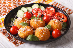 Italian arancini rice balls with cheese closeup. horizontal Royalty Free Stock Photos