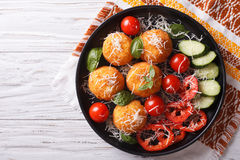 Italian arancini rice balls with cheese. horizontal top view. Italian arancini rice balls with cheese and fresh vegetables on the plate. horizontal top view Stock Image
