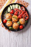 Italian arancini rice balls with cheese. vertical top view. Italian arancini rice balls with cheese and fresh vegetables on the plate. vertical top view Stock Image