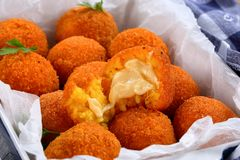 Arancini - saffron rice balls stuffed with cheese. Italian arancini - saffron rice balls stuffed with cheese in baking dish, view from above, close-up Stock Photography