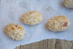 Italian arancini before to be fried. Preparing Italian fried rice balls or arancini Royalty Free Stock Photography