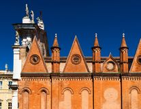 Italian architecture. The Cathedral of Mantua Mantova. One of the main landmarks of the city. Wall with triangle ornament and columns made of red brick Stock Images