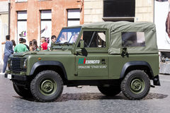 Italian army off-road car  (Esercito). An italian army off-road car parking on a street in the historic center of the city of Rome (Italy). Behind many tourist Stock Photo