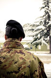 Italian army soldier. Italian army female soldier from back Stock Images