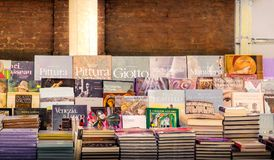 Italian art books on a book stand in Rome royalty free stock photos