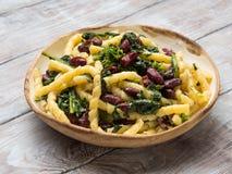 Italian artisanal pasta with kidney beans. Italian artisanal fresh pasta with kidney beans and broccoli Royalty Free Stock Photos