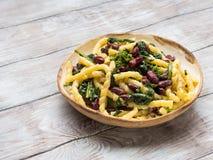 Italian artisanal pasta with kidney beans. Italian artisanal fresh pasta with kidney beans and broccoli Royalty Free Stock Photography