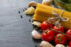 Italian background with pasta and tomatoes Stock Image