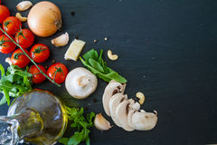Italian background with tomatoes olive oil mushrooms Royalty Free Stock Image