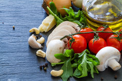 Italian background with tomatoes olive oil mushrooms Royalty Free Stock Photography