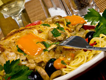 Italian Baked Chicken. On a plate served with pasta royalty free stock photos