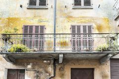 Italian balcony in Cuneo. Architecture of the Medieval Piedmont City of Cuneo in Italy. Vintage Italian balcony in Mediterranean style Stock Photo