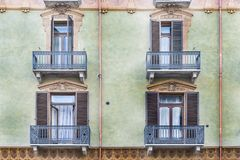 Italian balcony in Cuneo. Architecture of the Medieval Piedmont City of Cuneo in Italy. Vintage Italian balcony in Mediterranean style Stock Photography