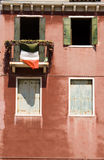 Italian balcony with flag Royalty Free Stock Images