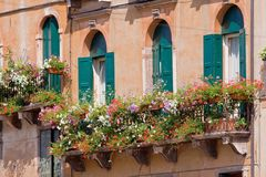 Italian balcony with flowerpots and flowers Royalty Free Stock Image