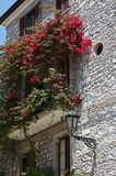 Italian balcony with flowers Royalty Free Stock Photography