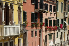 Italian balcony with flowers Royalty Free Stock Images