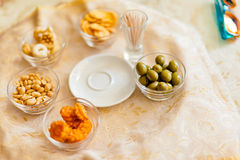 Italian Bar Aperitive. Nuts, olive, rices and other appetizer served in italian bars Stock Photography