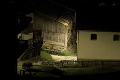 Italian Barn at Night. This barn was photographed in Cortina - Italy at night. A nice game of light and shadows with beautiful peaceful colors Royalty Free Stock Photo