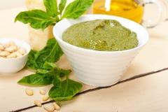Italian basil pesto sauce ingredients. Italian traditional basil pesto sauce ingredients on a rustic table Royalty Free Stock Photography
