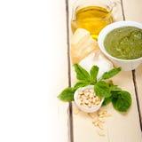 Italian basil pesto sauce ingredients. Italian traditional basil pesto sauce ingredients on a rustic table Stock Photo