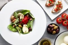 Italian basil salad and traditional bruschetta Stock Image