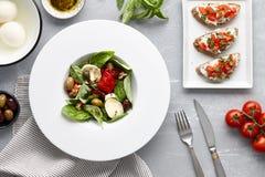 Italian basil salad and traditional bruschetta Royalty Free Stock Photo