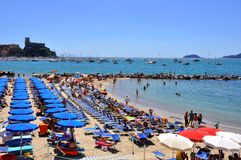 Italian beach and tourists in Liguria  Stock Photography