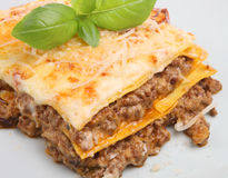 Italian Beef Lasagna. Beef lasagne garnished with basil and grated parmesan Stock Photography