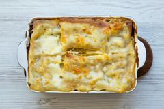 Italian beef lasagne on a white wooden background. Top view. Italian beef lasagne on a white wooden background. n Top view stock photography