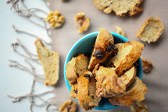 Italian biscotti cookies with nuts in the blue bowl on the table with grey linen tablecloth Royalty Free Stock Photo