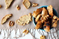 Italian biscotti cookies with nuts in the blue bowl on the table with grey linen tablecloth Stock Images