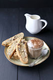 Italian biscotti on plate with a cup of coffee Stock Photos