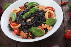 Italian black spaghetti pasta. With mussels and squid rings Stock Photography
