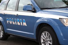 Italian blue police car in the road with written POLICE Royalty Free Stock Photos
