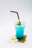 Italian blue soda and Plumeria flower Royalty Free Stock Images