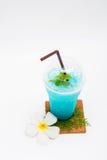 Italian blue soda and Plumeria flower Royalty Free Stock Photography