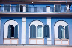 Italian blue windows. Three blue windows in an traditional Italian house - Mergozzo - Italy Stock Image