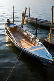 Italian boats. Wooden rowboats at the docks stock images