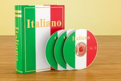Italian book with flag of Italy and CD discs on the wooden table. 3D Royalty Free Stock Photos