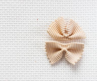 Italian bows farfalle pasta from durum wheat,  top view Royalty Free Stock Photography