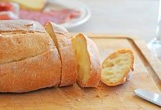 Italian bread. Fresh sliced Italian bread on wooden breadboard, shallow depth of field Royalty Free Stock Photography