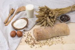 Bread with cereals on a wooden table. Italian bread with cereals and grain on a wooden gray table Stock Images