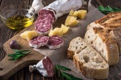 Italian bread Ciabatta, salami and cheese Parmesan Royalty Free Stock Photos