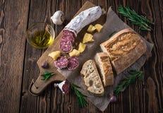 Italian bread Ciabatta, salami and cheese Parmesan Royalty Free Stock Images