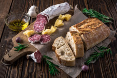 Italian bread Ciabatta, salami and cheese Parmesan Royalty Free Stock Photo