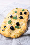 Italian bread focaccia with olive, garlic and mint, vertical stock photography
