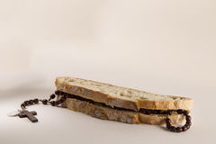 Italian bread and Holy Rosary Royalty Free Stock Photo