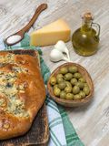 Bread with olives on a wooden table. Stock Photo
