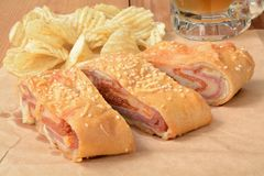 Italian bread roll with chips and beer Stock Photography